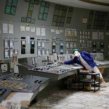 FILE PHOTO: An employee is seen in a control centre of one of the stopped reactors at the Chernobyl Nuclear Power Plant