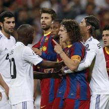 'Real Madrid\'s players and Lassana Diarra (C) react against Barcelona\'s players and captain Carles Puyol (3rd R) during their Champions League semi-final first leg soccer match at Santiago Bernabeu
