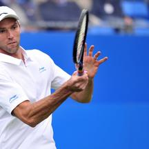 'Ivo Karlovic of Croatia returns against Lleyton Hewitt of Australia during their match on the second day of the Aegon Championships tennis tournament at the Queen\'s Club in west London on June 12, 2