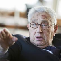 'Former U.S. Secretary of State Henry Kissinger gestures during a reception for his 90th birthday in Berlin, June 11, 2013. The reception was held by German multimedia company Axel Springer AG. Kissin