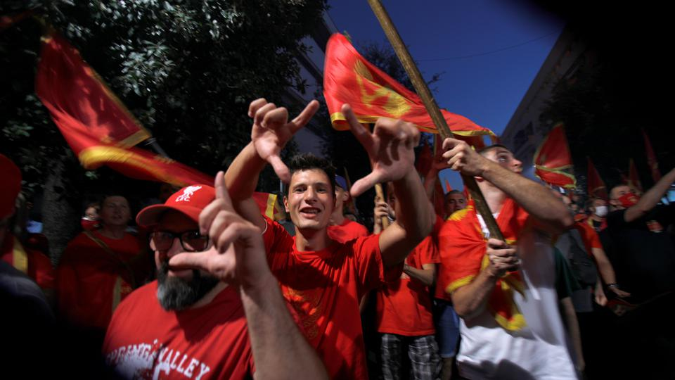 Man shout slogans during post-election patriotic rally in Podgorica