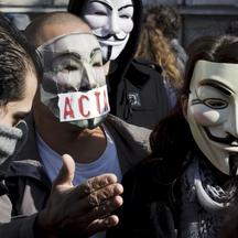 'Protesters wearing Anonymous Guy Fawkes masks take part in a demonstration against controversial Anti-Counterfeiting Trade Agreement (ACTA), on March 10, 2012 in Lyon, central-eastern France. AFP PHO
