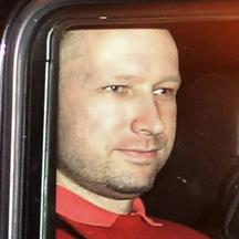 \'Norwegian Anders Behring Breivik, the man accused of a killing spree and bomb attack in Norway, sits in the rear of a vehicle as he is transported in a police convoy as he is leaving the courthouse