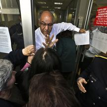 'A Laiki Bank manager tries to calm depositors waiting for the opening of the bank's branch in Nicosia March 28, 2013. Banks in Cyprus opened their doors on Thursday for the first time in almost two