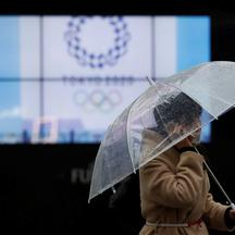 A passerby wearing a protective face mask walks past a display showing the logo of Tokyo 2020 Olympic Games, amid the coronavirus disease (COVID-19) outbreak in Tokyo