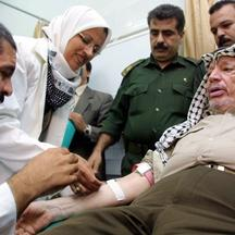 '(FILES) -- File picture dated 12 September 2001 shows Palestinian leader Yasser Arafat (R) gives blood at Shifa hospital in Gaza City, in the Gaza Strip 12 September 2001. Palestinians citizens have