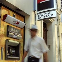 'A passer-by walks in front of cash machines of French bank Societe Generale in Marseille, September 13, 2011. Chief executive Frederic Oudea told a German financial daily newspaper that the French ba