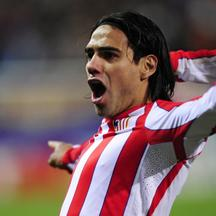 'Atletico Madrid's Colombian midfielder Radamel Falcao celebrates  after scoring his team's fourth goal during the UEFA Europa League first leg semi-final football match Atletico Madrid vs Valencia