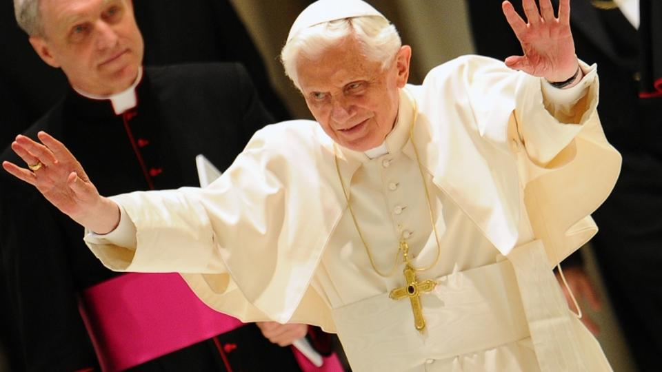 'Pope Benedict XVI waves as he arrives for an audience with youths of Madrid archidiocese who took part in the 2011 World Youth Day celebration in the Spanish capital on April 2, 2012 at Paul VI hall