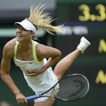 'Maria Sharapova of Russia serves to Anastasia Rodionova of Australia during their women's singles tennis match at the Wimbledon tennis championships in London June 25, 2012.           REUTERS/Dylan
