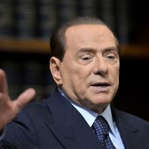 'Former Italian Prime Minister Silvio Berlusconi speaks during a press conference on May 25, 2012 at the senate in Rome. Berlusconi suggested during a press conference with the secretary general of th