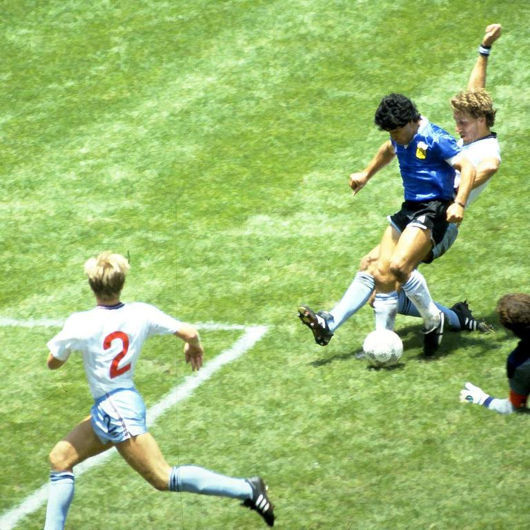 FILE PHOTO: Diego Maradona scores for Argentina
