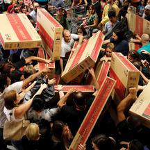 Shoppers reach for television sets as they compete to purchase retail items on Black Friday at a store in Sao Paulo Shoppers reach for television sets as they compete to purchase retail items on Black Friday at a store in Sao Paulo, Brazil, November 24, 2