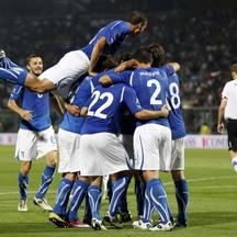 \'Italy\'s Antonio Cassano (obscured) celebrates with teammates after scoring against Estonia during their Euro 2012 Group C qualifying soccer match at the Braglia stadium in Modena June 3, 2011. REUT