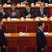 'China's outgoing President Hu Jintao (front row R) and China's Communist Party Chief Xi Jinping arrive as delegates clap during the closing ceremony of the Chinese People's Political Consultative