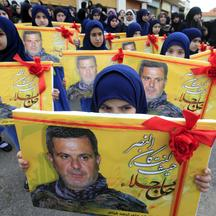 Lebanon's Hezbollah al-Mahdi girl scouts carry pictures of Ali Fayyad, one of Hezbollah's senior commanders who was killed fighting alongside Syrian army forces in Syria, during his funeral in Ansar village, southern Lebanon March 2, 2016. REUTERS/Ali Has