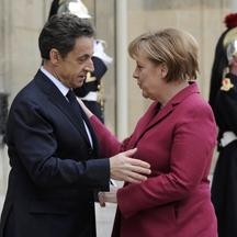 \'France\'s President Nicolas Sarkozy (L) greets German Chancellor Angela Merkel at the Elysee Palace ahead of international talks on Libya in Paris March 19, 2011. World leaders gather in Paris on Sa