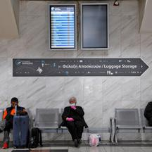 People wait at the Macedonia Intercity Bus Station during the coronavirus disease (COVID-19) outbreak ahead of the Orthodox Easter, in Thessaloniki