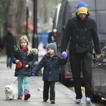'EXCLUSIVE ALL-ROUND PICTURES  WORLD RIGHTS  Chris Martin and his kids Moses and Apple take the dog for a walk, London, UK. 23/01/2011  BYLINE DAN BOZINOVSKI/BIGPICTURESPHOTO.COM:   REF:001/ZB  USAGE