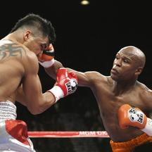'WBC welterweight champion Victor Ortiz (L) of the U.S. takes a punch from Floyd Mayweather Jr., also of the U.S., during their title fight at the MGM Grand Garden Arena in Las Vegas, Nevada, Septembe