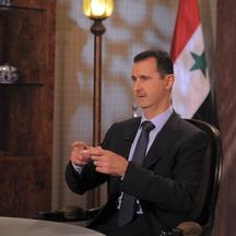 'Syria's President Bashar Assad speaks during an interview with Syrian state television in Damascus August 21,2011, in this handout photograph released by Syria's national news agency SANA. Syrian