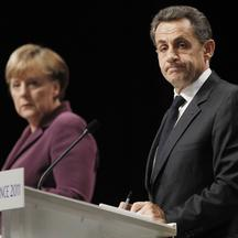 'epa02990166 French President Nicolas Sarkozy (R) and German Chancellor Angela Merkel (L) hold a press conference, in Cannes, France, 02 November 2011, at the end of the emergency meeting set up to di
