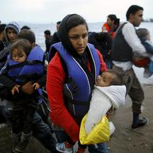 Afghan immigrants land at a beach on the Greek island of Kos after crossing a portion of the south-eastern Aegean Sea between Turkey and Greece on a dinghy early May 27, 2015. Despite the bad weather at least a dingy with over thirty migrants made the dan