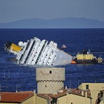'(FILES) This file picture taken on January 25, 2012 shows the stricken cruise liner Costa Concordia off the Isola del Giglio. Environmental campaign group Greenpeace on March 9, 2012 warned that chem