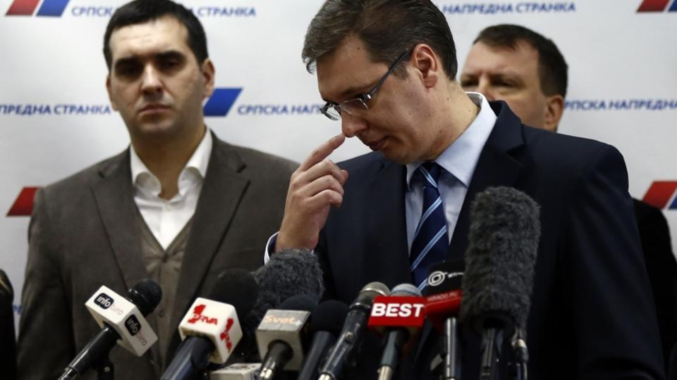 'Serbian Progressive Party (SNS) leader and Serbian defence Minister Aleksandar Vucic (C) gestures during a media conference in his party's headquarters in Belgrade February 4, 2013. Analysts said Se