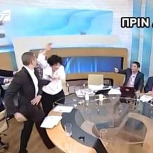 'epa03252376 A TV grab taken from Greek private Antenna television station, shows Elias Kassidiaris (2L), former MP and party press spokesman of Greek far-ight Chryssi Avghi (Golden Dawn) party, slapp