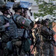 Members of the Wisconsin National Guard stand by as people gather for a vigil, following the police shooting of Jacob Blake, a Black man, in Kenosha, Wisconsin
