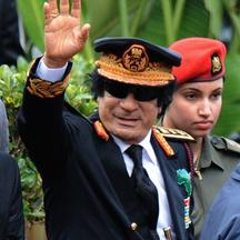 \'Libyan leader Muammar Gaddafi greets the crowd at the inauguration ceremony of South Africa\'s newly elected president Jacob Zuma in Pretoria on May 9, 2009. Zuma is the county\'s fourth President s