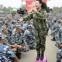 'China's new first lady and singer Peng Liyuan sings during a performance as she visits soldiers and residents after the Wenchuan earthquake in Deyang, Sichuan province June 21, 2008. Peng is best kn