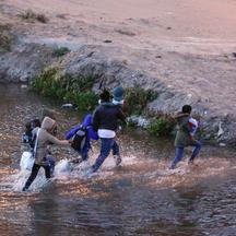 Migrants cross the Rio Bravo river to turn themselves in to U.S Border Patrol agents to request for asylum in El Paso, Texas, U.S., as seen from Ciudad Juarez