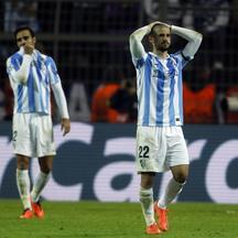 'Malaga's Isco (R) walks from the pitch dejected after defeat to Borussia Dortmund in the Champions League quarter-final second leg soccer match, in the western German city of Dortmund April 9, 2013.