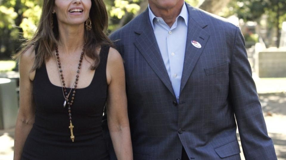 'California Governor Arnold Schwarzenegger holds hands with his wife Maria Shriver (L) as he walks to address the media after voting in the midterm elections at the Crestwood Hills Recreation Center i