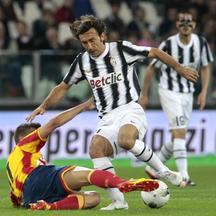 'Juventus\' Andrea Pirlo (L) challenges Lecce\'s Haris Seferovic during their Italian Serie A soccer match at the Juventus stadium in Turin May 2, 2012.     REUTERS/Stefano Rellandini  (ITALY - Tags: