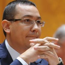 'Romanian prime minister-designate Victor Ponta attends a session of the Romanian Parliament in Bucharest on May 7, 2012. Romania\'s new centre-left government will seek formal approval from parliamen
