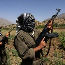 'This file photo taken on June 12, 2007 shows Kurdistan Workers\' Party (PKK) rebels patroling an area in the Iraqi part of Qandil Mountains near their headquarters on the Iraqi-Iranian-Turkish border
