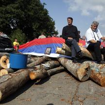 \'Kosovo Serbs sit on the barricades in the village of Zupce near the town of Zubin Potok August 1, 2011. Serbs vowed to press on with roadblocks and stop NATO\'s KFOR peacekeeping force from proceedi