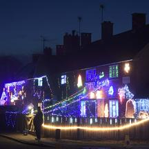 Visitors and locals view Christmas displays on dozens of properties that have been decorated in thousands of lights in a tradition that has grown over recent years in the small village of Westfield in Sussex, south east England, December 15, 2016. Picture
