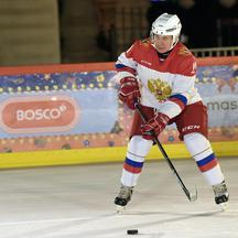Russia's Putin played hockey with the boy who had said it was his dream, in Moscow