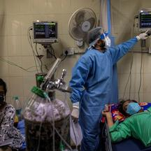 FILE PHOTO: Patients suffering from the coronavirus disease (COVID-19) get treatment at the casualty ward in Lok Nayak Jai Prakash (LNJP) hospital, amidst the spread of the disease in New Delhi