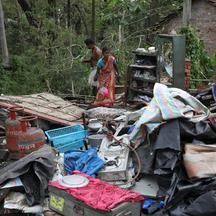 Residents salvage their belongings from the rubble of a damaged house in the aftermath of Cyclone Amphan, in South 24 Parganas