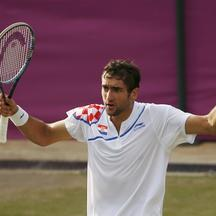 'Croatia\'s Marin Cilic argues with the referee over a call during his men\'s singles tennis match against Australia\'s Lleyton Hewitt at the All England Lawn Tennis Club during the London 2012 Olympi